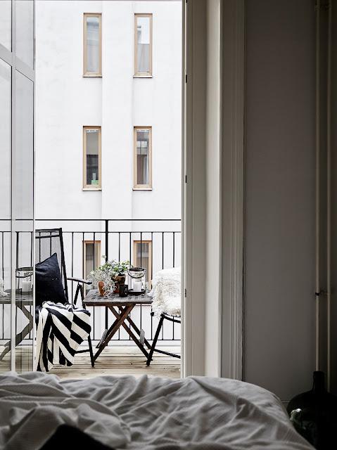 bedroom with cozy little balcony