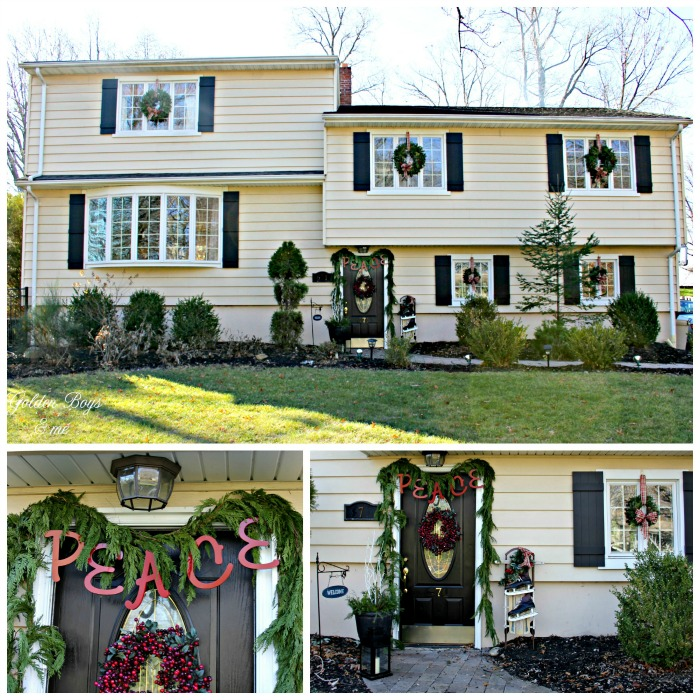 Split level home decorated for Christmas with Peace letters over door and fresh wreaths and garland - www.goldenboysandme.com