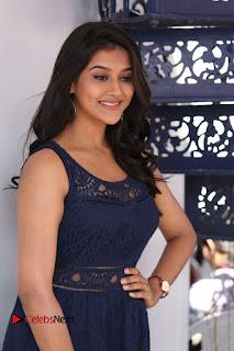 Actress Pooja Jhaveri Stills in Short Dress at Dwaraka Movie Interview  0037