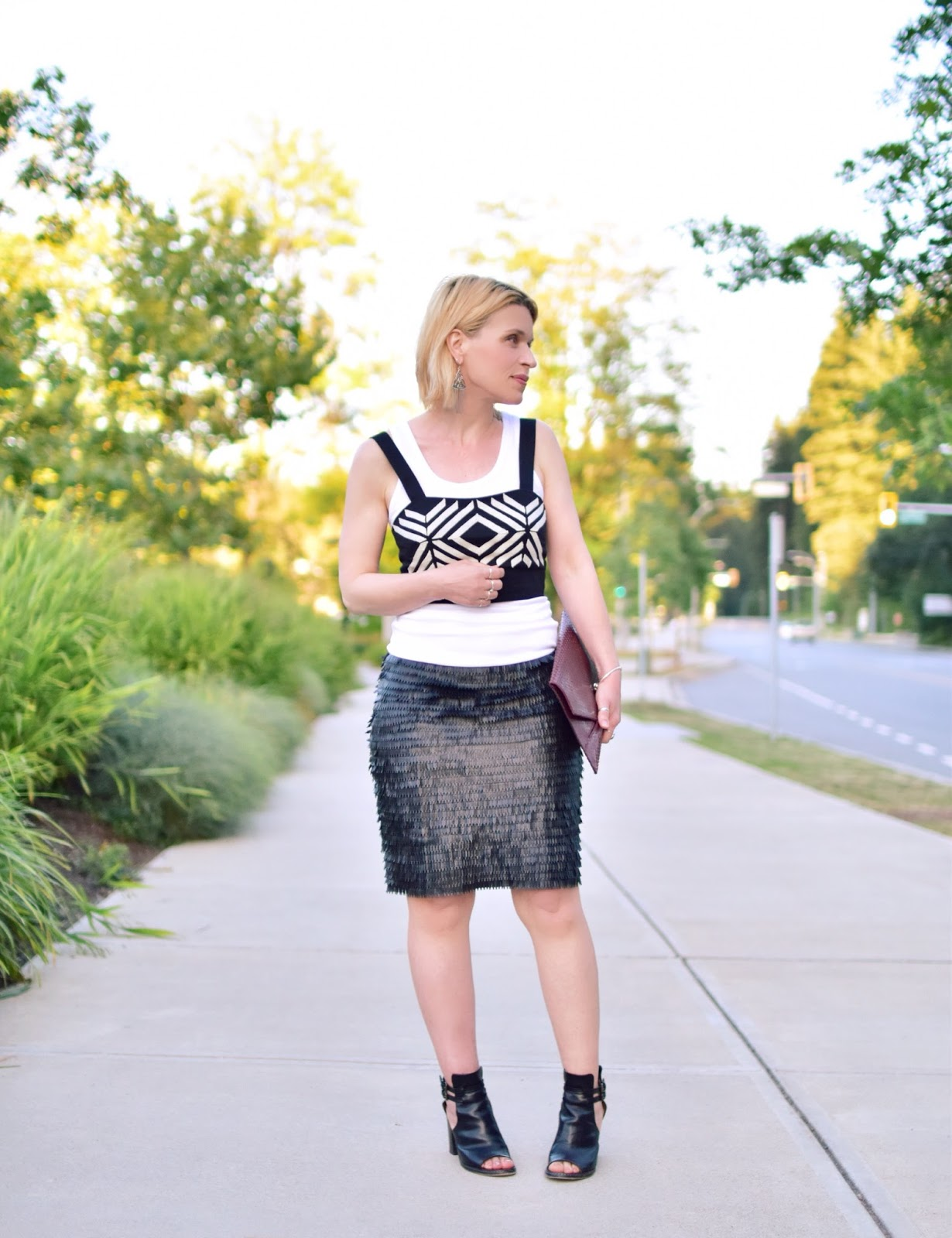 88992f75a Monika Faulkner styles a textured faux-leather skirt with a boyfriend tank  and graphic crop ...