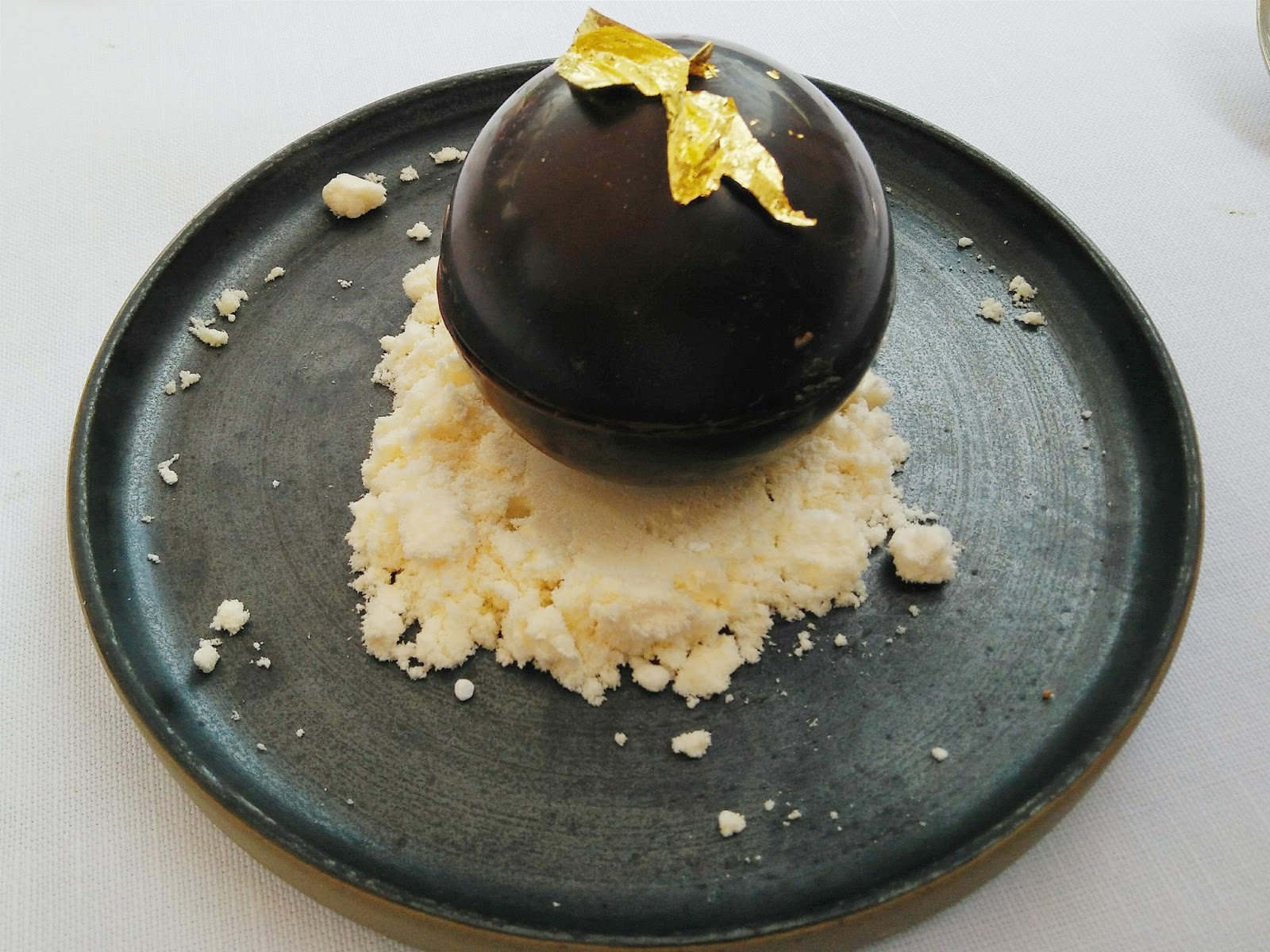Chocolate sphere dessert at Great Fosters Estate Grill