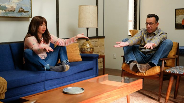 screenshot of a scene from Forever in which Maya Rudolph and Fred Armisen are sitting in funny positions in a mid-century modern living room