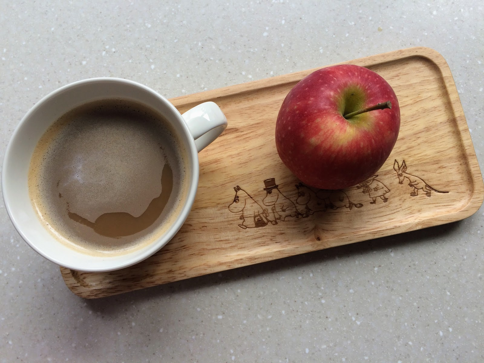 coffee and apple on moomin tray