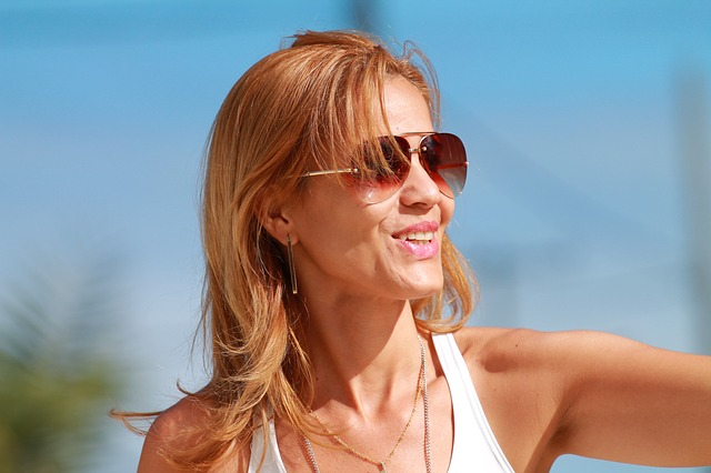 Sunburn Home Remedies for Calming Relief Illustrated by Woman with sunglasses in sun