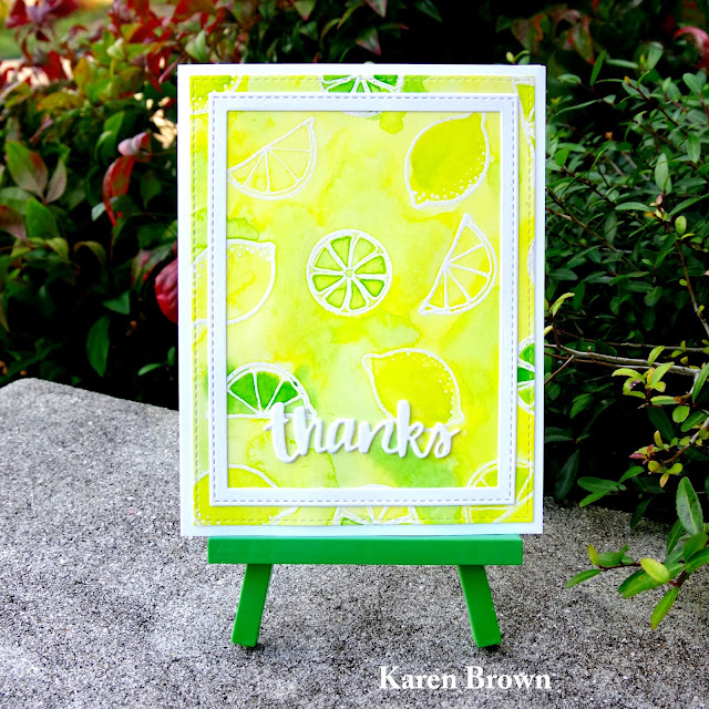Watercolor stamped background in yellow and lime green.