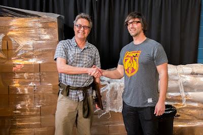 Josh Haney congratulating Scott Anderson on his Lead by Example Award
