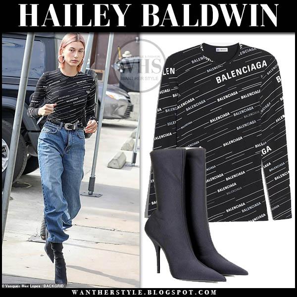 Hailey Baldwin in black balenciaga logo top, jeans and black balenciaga sock boots model style january 20