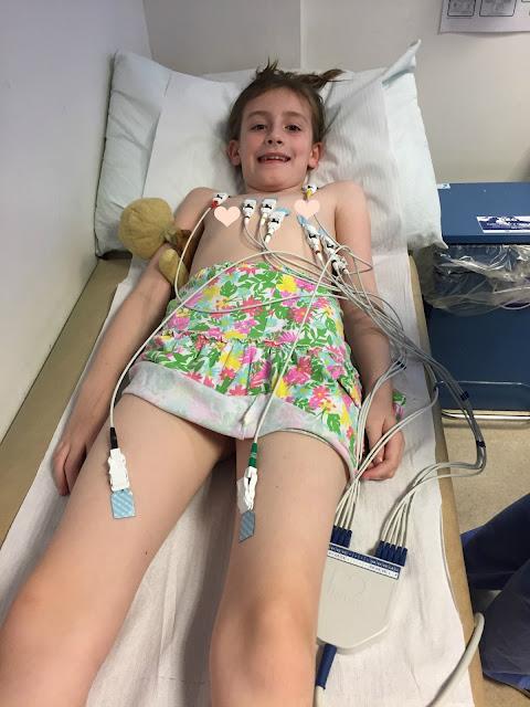 shows girl having Electrocardiogram ECG