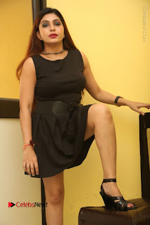 Tollywood Upcoming Actress Pooja Roshan Stills in Black Short Dress at Plus 1 Movie Trailer Launch  0168.JPG