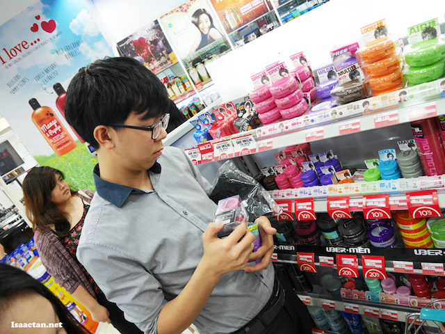 Joel Wong grabbing as many Ubermen products as he could hold in his hand