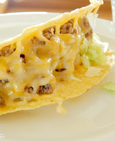 Beef & Bean Baked Tacos...delicious taco filling all baked in the shell.  Easy clean-up, a family favorite! (sweetandsavoryfood.com)
