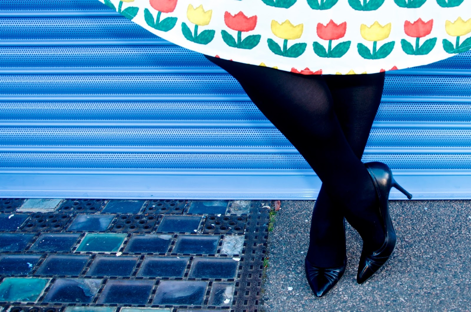 black heels, black tights and tulip print skirt