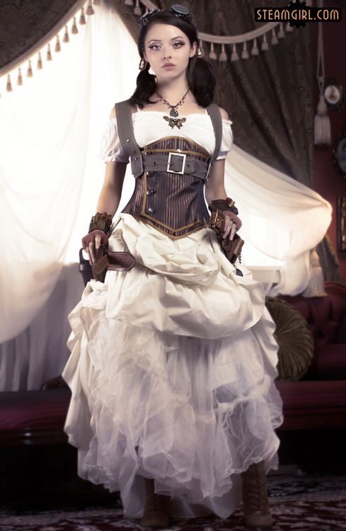 Steamgirl wearing a white dress, brown underbust corset, brown fingerless gloves, boots and goggles. Women's steampunk fashion