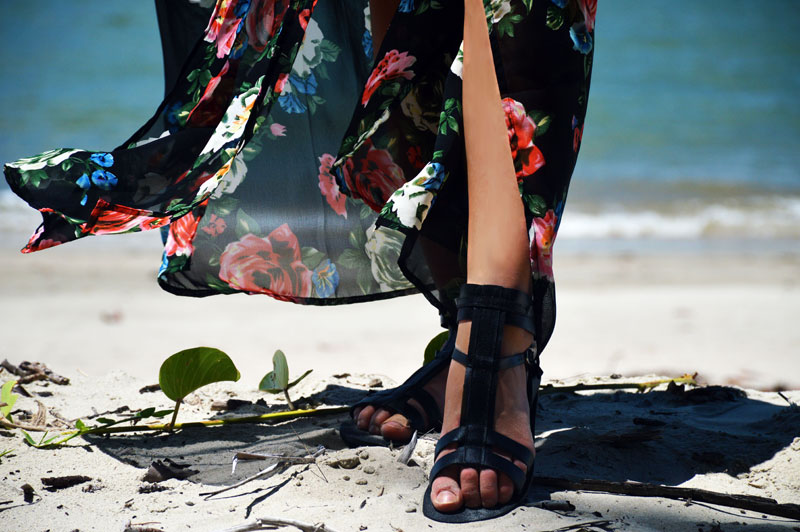 black gladiator sandals worn with beach maxi dress