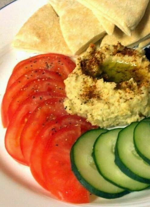 Vegetarian Snacks and Appetizers w/ Sliced Tomatoes, Cucumbers, and Warm Pita Bread Dipped in Homemade Hummus (Click for Recipe)