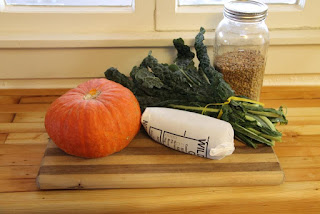 Kabocha squash, venison, kale, and lentils on a cutting board