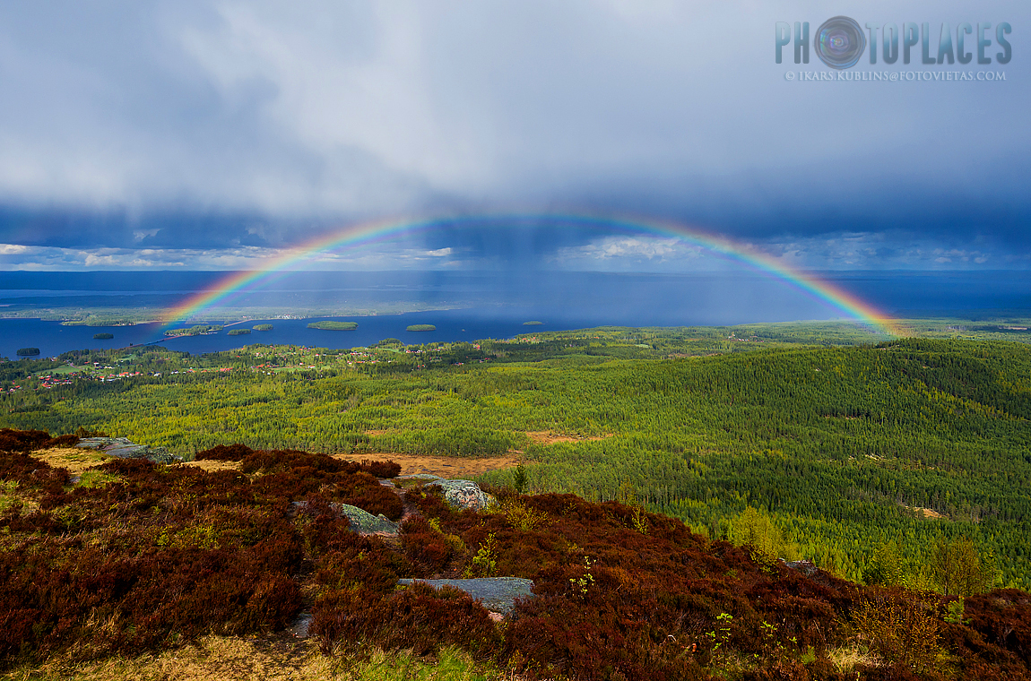 View from Gesundaberget hill to Siljan lake with a rainbow