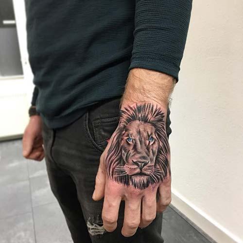 hand lion tattoo el üstü aslan dövmesi