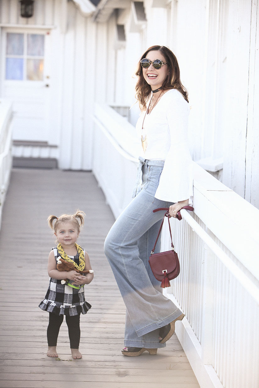 Amy West in wide leg bell bottoms and a bell sleeve tee