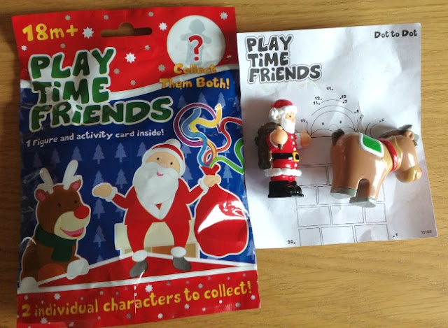 Picture of packet front with Father Christmas and a Rudolf with the figurines beside it