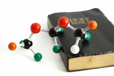 What is the tension between science and the Bible?