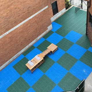 Greatmats staylock perforated plastic tiles courtyard