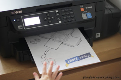 epson eco tank printing and child hand reaching out