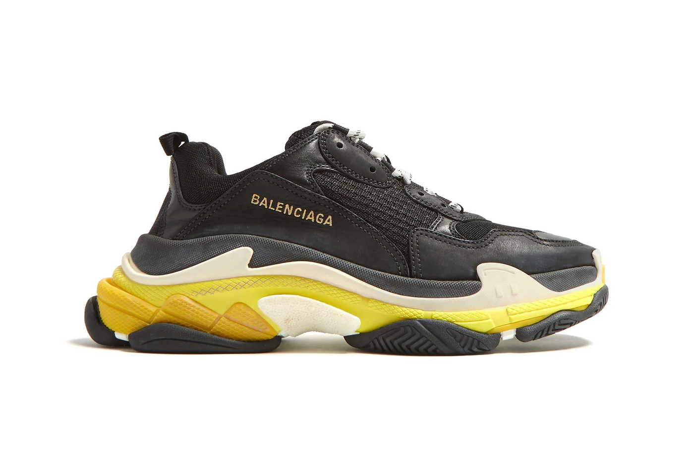 sale retailer 70709 512aa Balenciaga s Triple S Trainer continues its year long run atop the  ever-popular chunky sneaker trend with a new, versatile color combo of  black and yellow.
