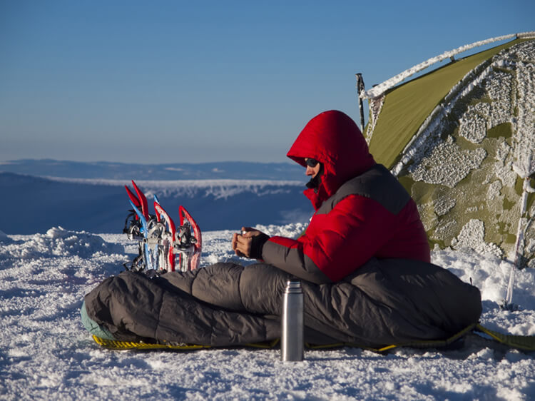 stay warm while winter camping with your tent and sleeping bag