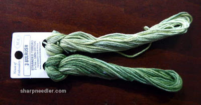 Pair of variegated House of Embroidery threads in greens for border on Herbier by Canevas Folies.