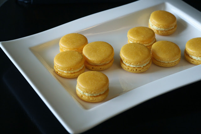 Plate of Saffron Cardamom Macarons arranged in groups of three