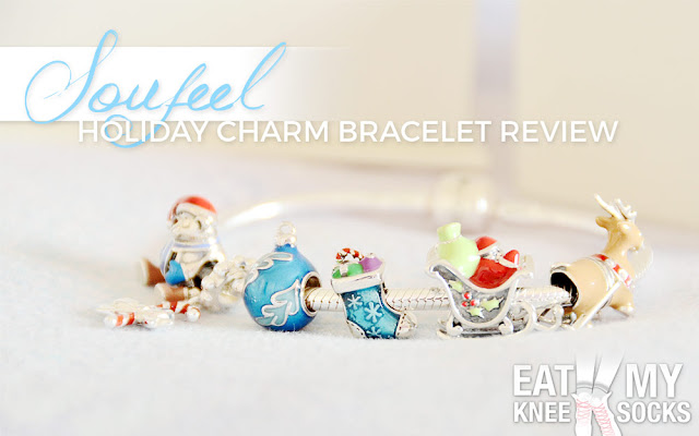 The Eat My Knee Socks/Mimchikimchi review of the Christmas-themed Pandora-style holiday charm bracelet from Soufeel, featuring sterling silver ornament, sleigh, Santa, reindeer, candy cane, and bear charms for the perfect winter gift.