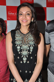 Kajal Aggarwal in lovely Black Sleeveless Anarlaki Dress in Hyderabad at Launch of Bahar Cafe at Madinaguda 033.JPG