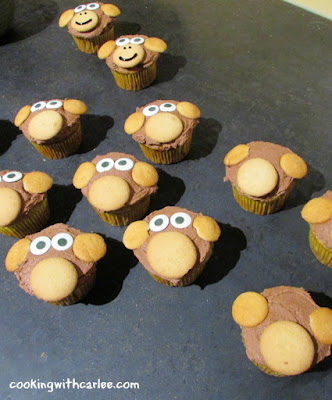 eyes added to cupcakes, starting to look like little monkey faces