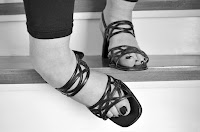 Picture of a woman's feet tripping on a stair.