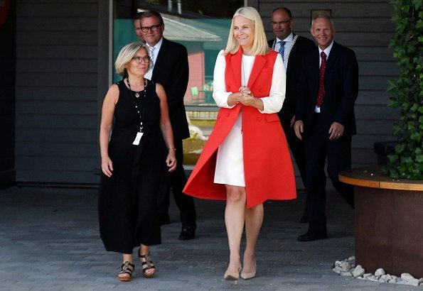 Crown Princess Mette-Marit wore ALTUZARRA double breasted sleeveless coat and she wore byTiMo pink Flared Midi Dress
