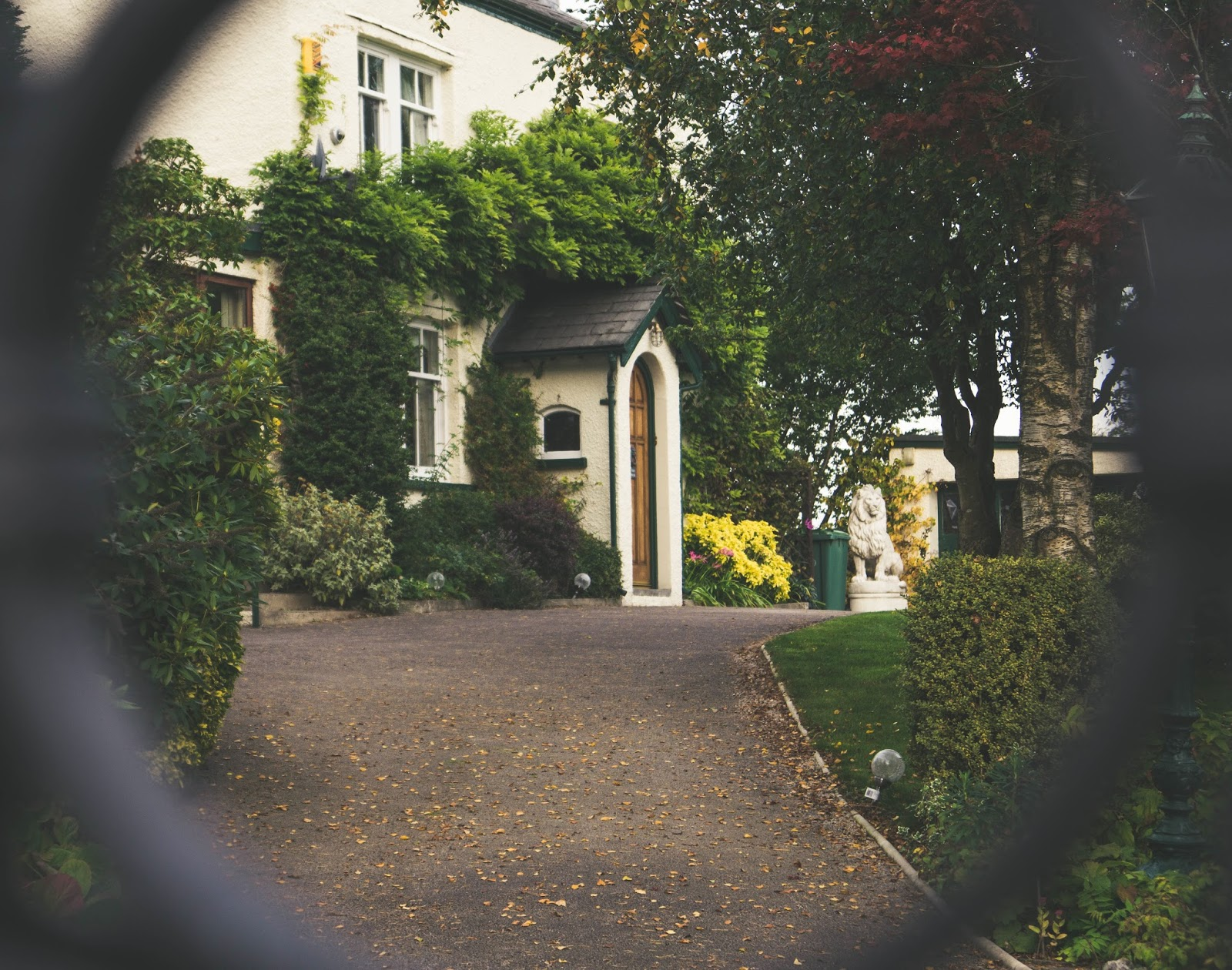 House seen through garden gate