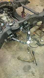 Passenger-side upper control arms