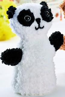 http://www.letsknit.co.uk/free-knitting-patterns/teddy-bear-and-panda-puppets
