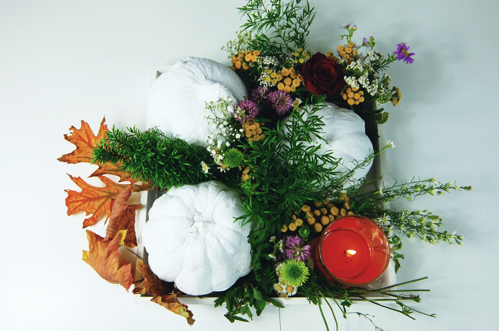 fall centrepiece with white pumpkin and flowers