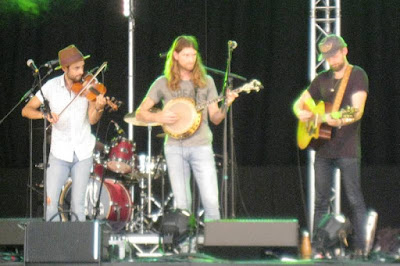 Three musicians: fiddle, banjo and guitar