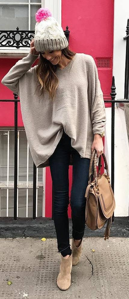 what to wear with a nude poncho : knit hat + bag + skinny jeans + boots