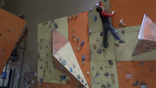 Boy Bouldering in Climbing Gym