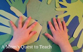kids hands on green hand prints
