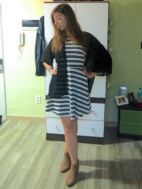 Sheer Fantasy | outfit of black and white striped skater dress, sheer black fabric cardigan, and brown suede heeled ankle boots