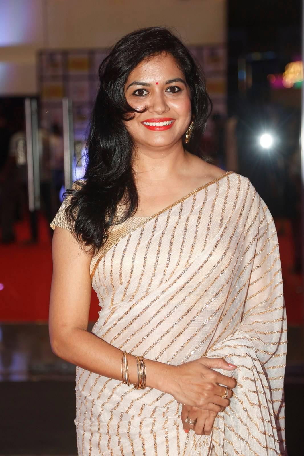 Beautiful Telugu Singer Sunitha Latest Stills In White Saree