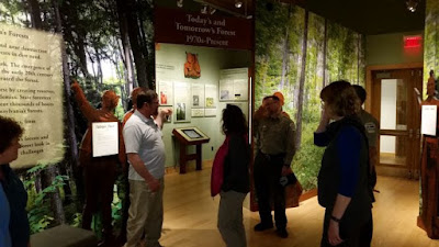 Visitors and staff in museum exhibit at PA Lumber Museum