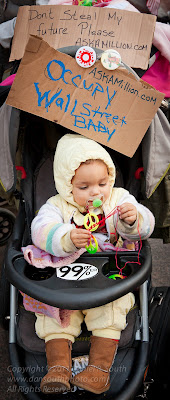 a photograph of a baby at the occupy wall street encampment in new york