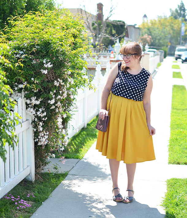 Thrifted polka dot top paired second-hand yellow midi skirt