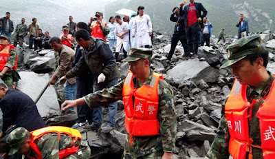 Landslide buries 46 homes in China, 141 missing